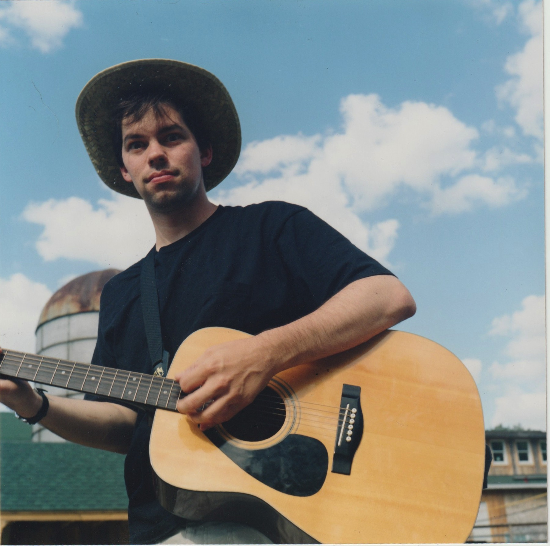 David Rhoden with an acoustic guitar in Deposit New York