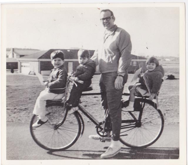 Me, Beverly, and Matt on a bike with our dad, about 1971
